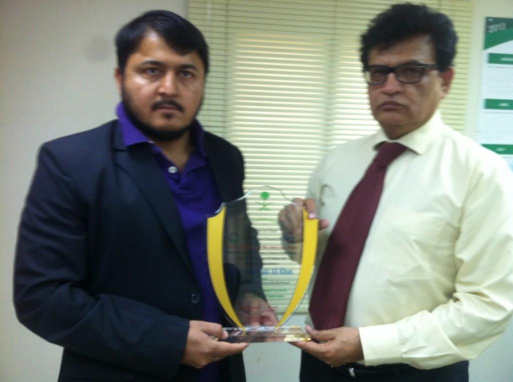 Shield Presented to Sardar Zaki Ali Khan Manager Alhamrani FUCHS (right) by RCA PRO Mr. Samiullah (left)